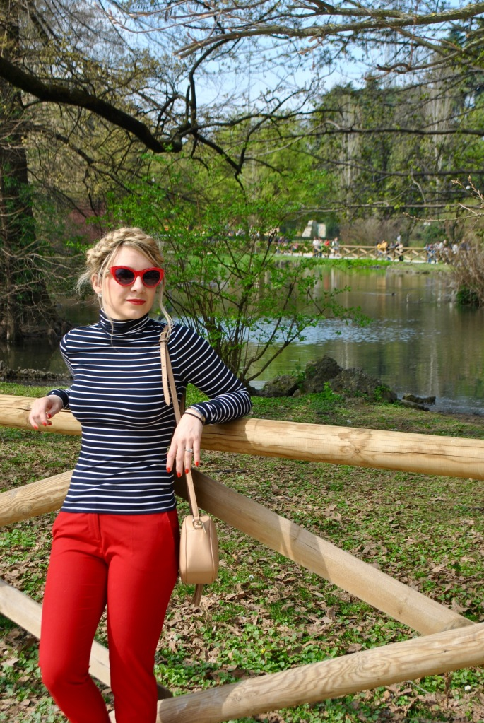 milan madame daniel red pants red sunglasses